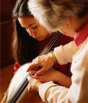 Teacher Instructing Student Cellist    Stock Photo - Premium Rights-Managed, Artist: Mitch Tobias, Code: 700-00190885