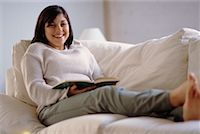fat italian woman - Woman Reading on Sofa    Stock Photo - Premium Rights-Managednull, Code: 700-00193401