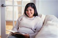 fat italian woman - Woman Reading on Sofa    Stock Photo - Premium Rights-Managednull, Code: 700-00193403
