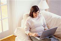 fat italian woman - Woman on Sofa Using Laptop    Stock Photo - Premium Rights-Managednull, Code: 700-00193442