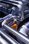 Worker Examining Pipe Installation    Stock Photo - Premium Rights-Managed, Artist: David Mendelsohn, Code: 700-00195742