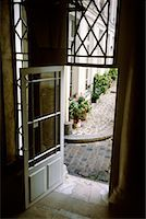 Open Door Leading into Courtyard    Stock Photo - Premium Rights-Managednull, Code: 700-00196178