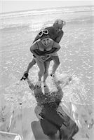 seniors and swim cap - Couple Playing on Beach    Stock Photo - Premium Rights-Managednull, Code: 700-00196925
