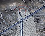 Prison Tower behind Barbed Wire    Stock Photo - Premium Rights-Managed, Artist: Guy Grenier, Code: 700-00197393