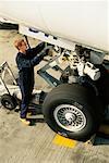 Airplane Mechanic Working on Landing Gear