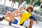 Young Man and Young Woman Sitting On Skateboard    Stock Photo - Premium Rights-Managed, Artist: Kevin Dodge, Code: 700-00197703