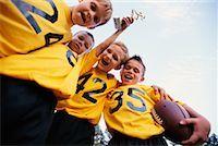 Boys Football Team Celebrating    Stock Photo - Premium Rights
