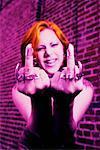 Woman making obscene gesture