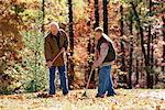 Grandfather and grandson raking leaves Stock Photo - Premium Royalty-Free, Artist: Shannon Ross, Code: 604-00225847