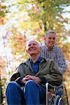 Grandson pushing grandfather in wheelchair Stock Photo - Premium Royalty-Free, Artist: Aflo Relax, Code: 604-00225874