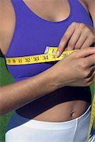 Woman measuring bust Stock Photo - Premium Royalty-Freenull, Code: 604-00228731