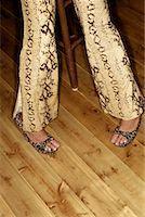 snake skin - Legs of woman Stock Photo - Premium Royalty-Freenull, Code: 604-00229784