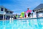 Children jumping into pool Stock Photo - Premium Royalty-Free, Artist: Tim Mantoani, Code: 604-00230545