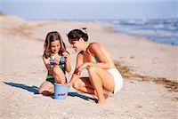 preteen bathing suit - Mother and daughter on beach Stock Photo - Premium Royalty-Freenull, Code: 604-00230907