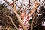 Man in tree Stock Photo - Premium Royalty-Free, Artist: Graham French, Code: 604-00231327
