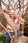 Man in tree Stock Photo - Premium Royalty-Free, Artist: Rick Gomez, Code: 604-00231328
