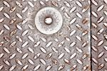 Bolt in metal grate Stock Photo - Premium Royalty-Free, Artist: photo division, Code: 604-00233292