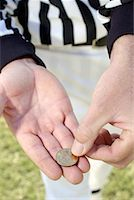 Referees hands with coin/ Stock Photo - Premium Royalty-Freenull, Code: 604-00233758