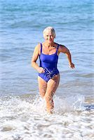 seniors woman in swimsuit - Woman in swimsuit in ocean/ Stock Photo - Premium Royalty-Freenull, Code: 604-00233808