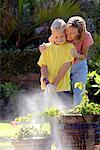 Mother and son watering flowers/ Stock Photo - Premium Royalty-Free, Artist: Masterfile, Code: 604-00233952