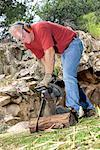 Man cutting log with chain saw/ Stock Photo - Premium Royalty-Free, Artist: Matt Brasier             , Code: 604-00234178
