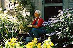 Woman Sitting in Garden    Stock Photo - Premium Rights-Managed, Artist: Strauss/Curtis, Code: 700-00263145