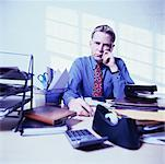 Businessman at Desk    Stock Photo - Premium Rights-Managed, Artist: Marnie Burkhart, Code: 700-00267595