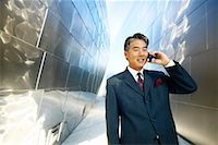 peter griffith - Businessman Using Cell Phone    Stock Photo - Premium Rights-Managednull, Code: 700-00268771