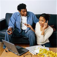 Couple Sitting on Sofa Discussing Their Personal Finances    Stock Photo - Premium Rights-Managednull, Code: 700-00269448
