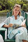 Woman Writing by Water    Stock Photo - Premium Rights-Managed, Artist: Peter Barrett, Code: 700-00270319