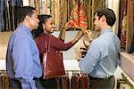 Salesman helping couple with fabric samples/ Stock Photo - Premium Royalty-Free, Artist: photo division, Code: 604-00278801