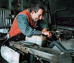 Man Working on Car    Stock Photo - Premium Rights-Managed, Artist: Ron Fehling, Code: 700-00280479