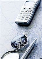 Compass, Cellular Phone Pen and Map    Stock Photo - Premium Royalty-Freenull, Code: 600-00280873