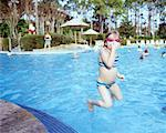 Girl Jumping into Pool    Stock Photo - Premium Rights-Managed, Artist: Tom Feiler, Code: 700-00281637