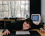 Businessman Sleeping at Desk    Stock Photo - Premium Rights-Managed, Artist: Noel Hendrickson, Code: 700-00286253
