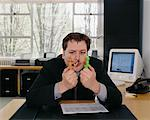 Businessman Playing with Toys At Desk    Stock Photo - Premium Rights-Managed, Artist: Noel Hendrickson, Code: 700-00286257