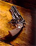 Pistol with Film Reel in Chamber    Stock Photo - Premium Rights-Managed, Artist: Anthony Redpath, Code: 700-00286347