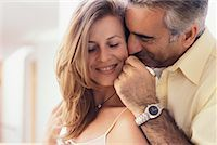 Man Putting Necklace Around Womans Neck    Stock Photo - Premium Rights-Managednull, Code: 700-00286571