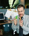Businessman Playing with Toys    Stock Photo - Premium Rights-Managed, Artist: Noel Hendrickson, Code: 700-00286702