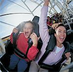 Mother and Son on a Roller Coaster Stock Photo - Premium Royalty-Freenull, Code: 613-00290735