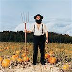 Man in Pumpkin Patch    Stock Photo - Premium Rights-Managed, Artist: Anthony Redpath, Code: 700-00329193