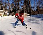 Boy Playing Hockey    Stock Photo - Premium Rights-Managed, Artist: Wayne Eardley, Code: 700-00341289