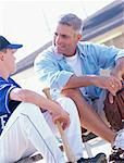 Father with Son on Baseball Diamond