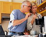Couple Making Coffee in Kitchen
