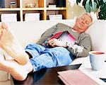Man Napping on Sofa