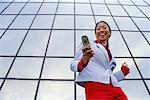 Business Woman Using Cell Phone    Stock Photo - Premium Rights-Managed, Artist: Kevin Radford, Code: 700-00345092