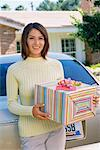 Woman Holding a Gift    Stock Photo - Premium Rights-Managed, Artist: Steve Craft, Code: 700-00350265