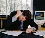 Man Pounding Stapler    Stock Photo - Premium Rights-Managed, Artist: Noel Hendrickson, Code: 700-00350703