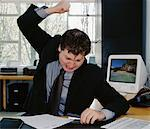 Man Pounding Stapler    Stock Photo - Premium Rights-Managed, Artist: Noel Hendrickson, Code: 700-00350704
