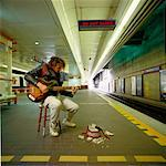 Busker on Subway Platform    Stock Photo - Premium Rights-Managed, Artist: Anthony Redpath, Code: 700-00350716